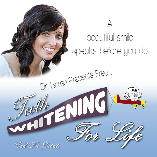 Beautiful woman smiling for free teeth whitening for life promotion at Dr. Dane Boren's office. Call for details